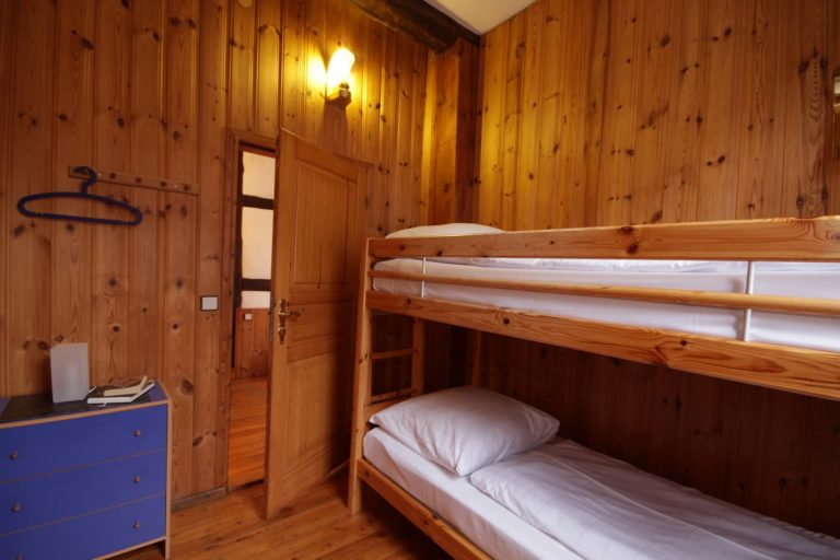 Schlafzimmer mit Etagenbett Apartment 11 - Teil der FeWo Flieder